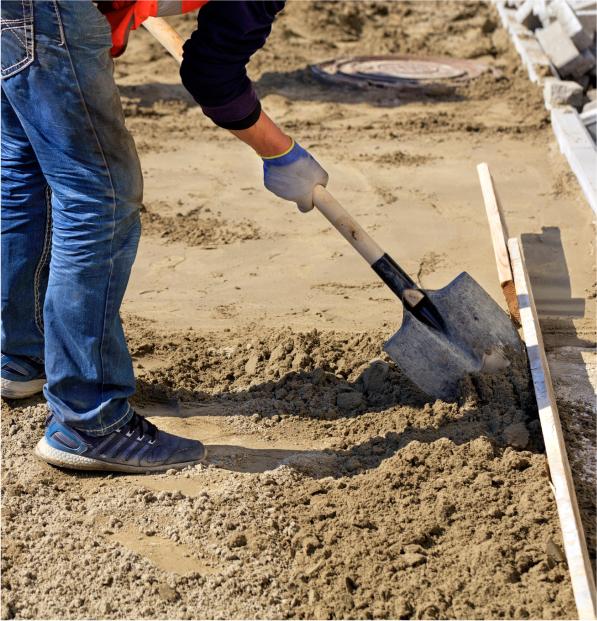 man shoveling sand