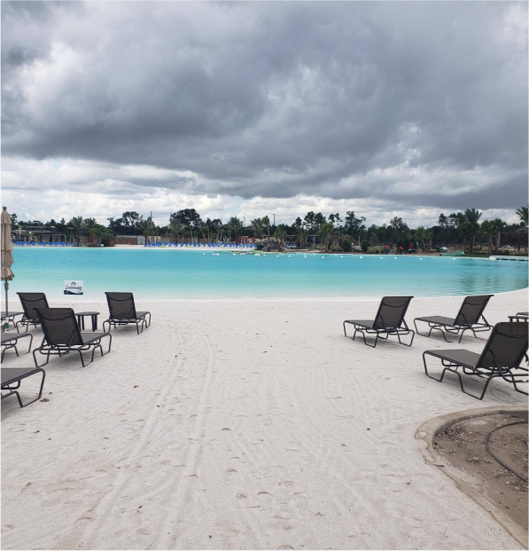 beach chairs on sand at crystal lagoon