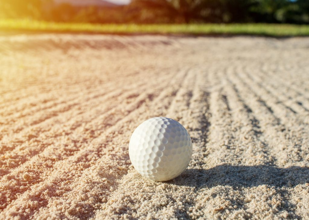 golf ball on raked sand