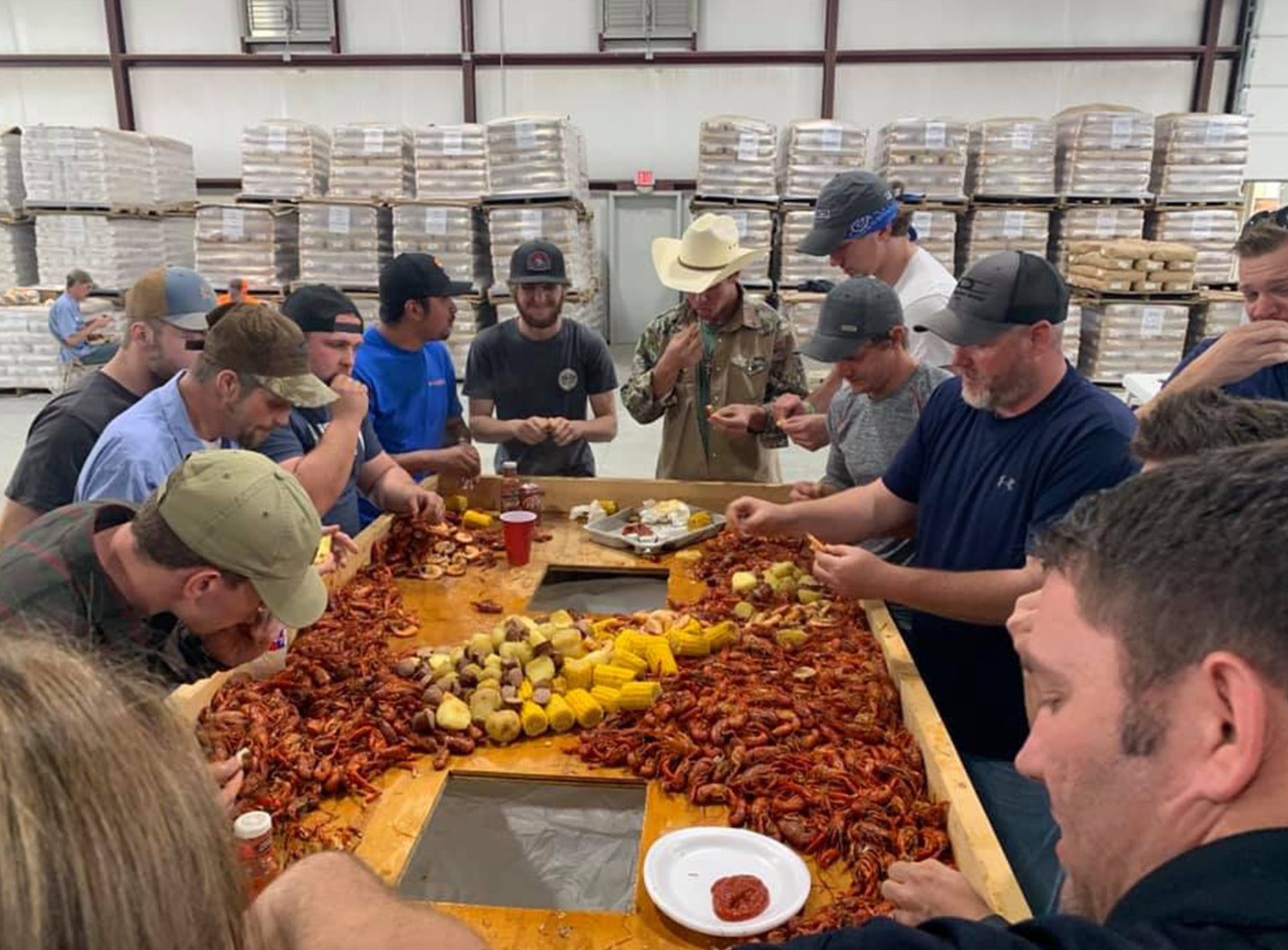 the hayden group employees enjoying a crawfish boil