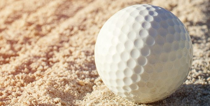golf ball on manicured sand