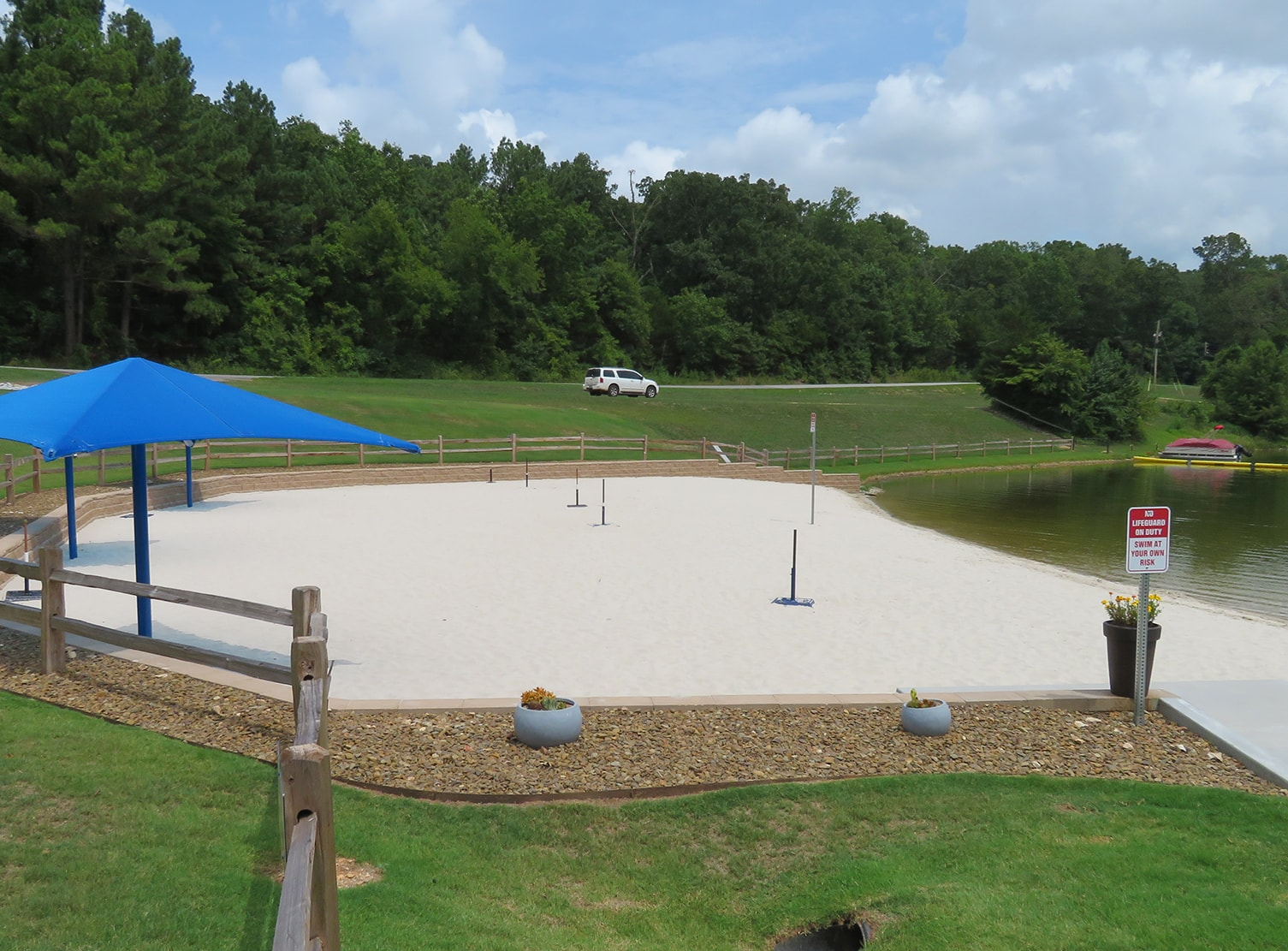 beach with white sand at man made lake