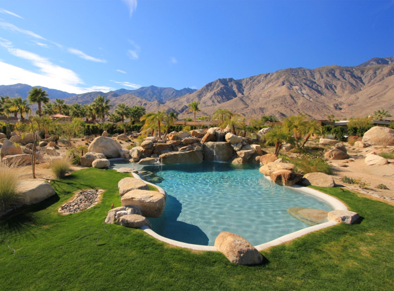 beautiful in-ground pool using pebble pool liner