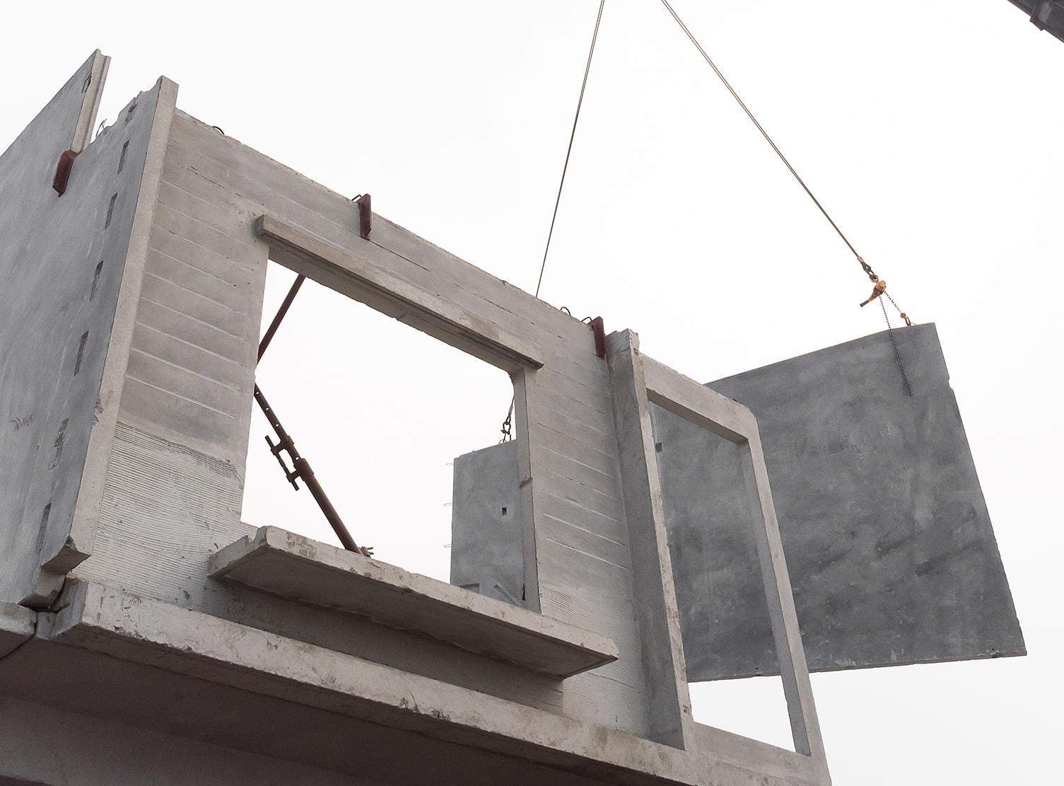 crane lifting precast walls