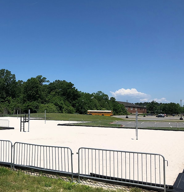 new sand in volleyball court at high school